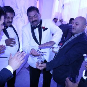 Marom performing for Roy C.J and Sohan Roy at event